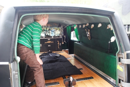 "Rian checks out a Zombie hearse.  Guy assured us the black bag was a ""real body bag.""  Whatever floats your boat."