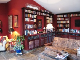Library with built in bookshelves and Indian slate floors.