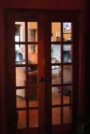 All doors are hand-crafted by Oldimar, one of the oldest and most respected woodworkers in Boquete, from Cedro. Looking toward Living Room.