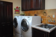 Laundry room with Whirlpool Duet washer & dryer